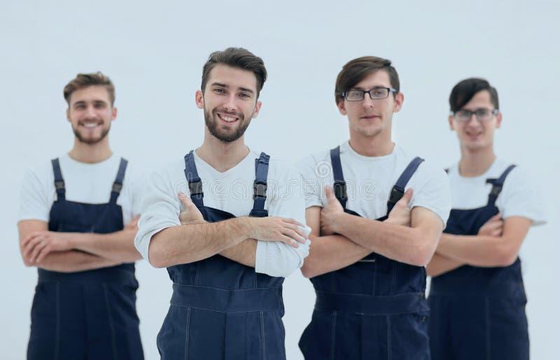 Équipe heureuse de moteurs responsables et de leur chef de sourire photo stock