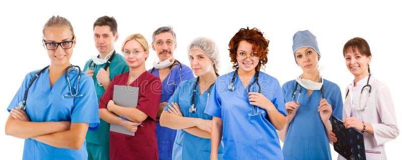 Équipe médicale souriante de huit personnes photos libres de droits