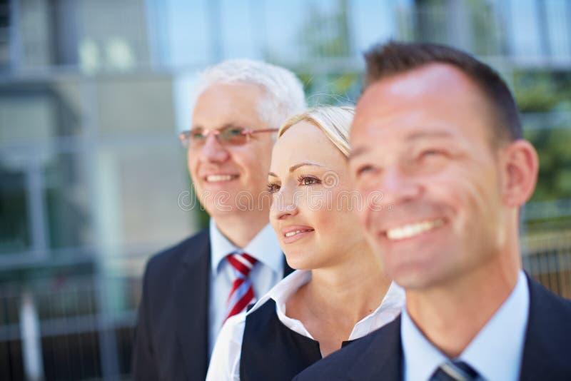 Équipe visionnaire d'affaires dans une ligne images libres de droits
