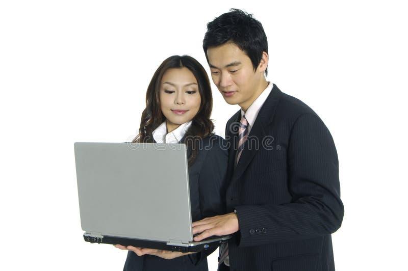 équipes asiatiques d'affaires images stock