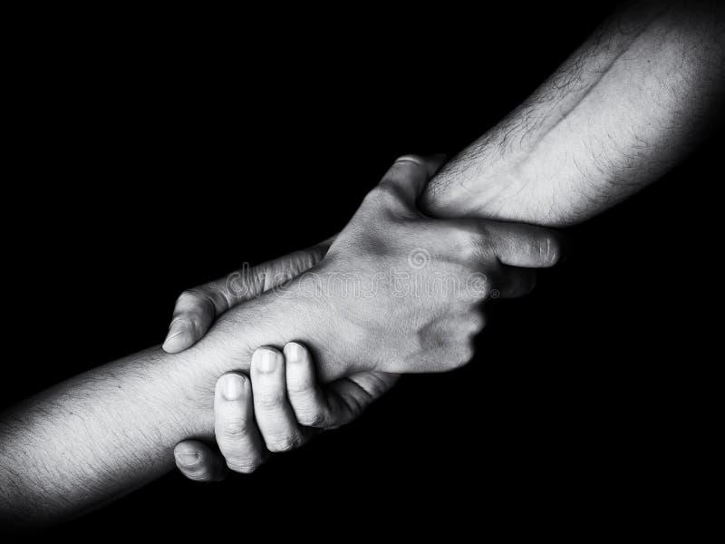 Équipez l'économie, sauvant et aidant la femme en se tenant ou ronchonnant l'avant-bras photographie stock libre de droits