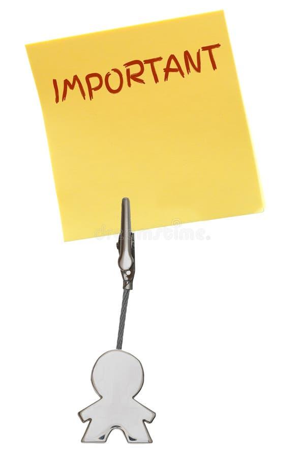 Équipez la figure support de carte de visite professionnelle de visite avec la note de papier jaune IMPORTANTE images stock