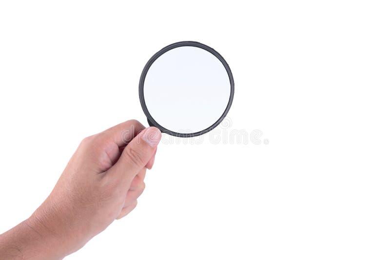 Équipez la main avec la loupe jugeant le classique dénommé d'isolement photographie stock libre de droits