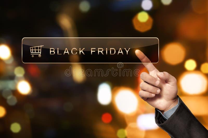 Équipez la main touchant Black Friday dans la barre de recherche images libres de droits