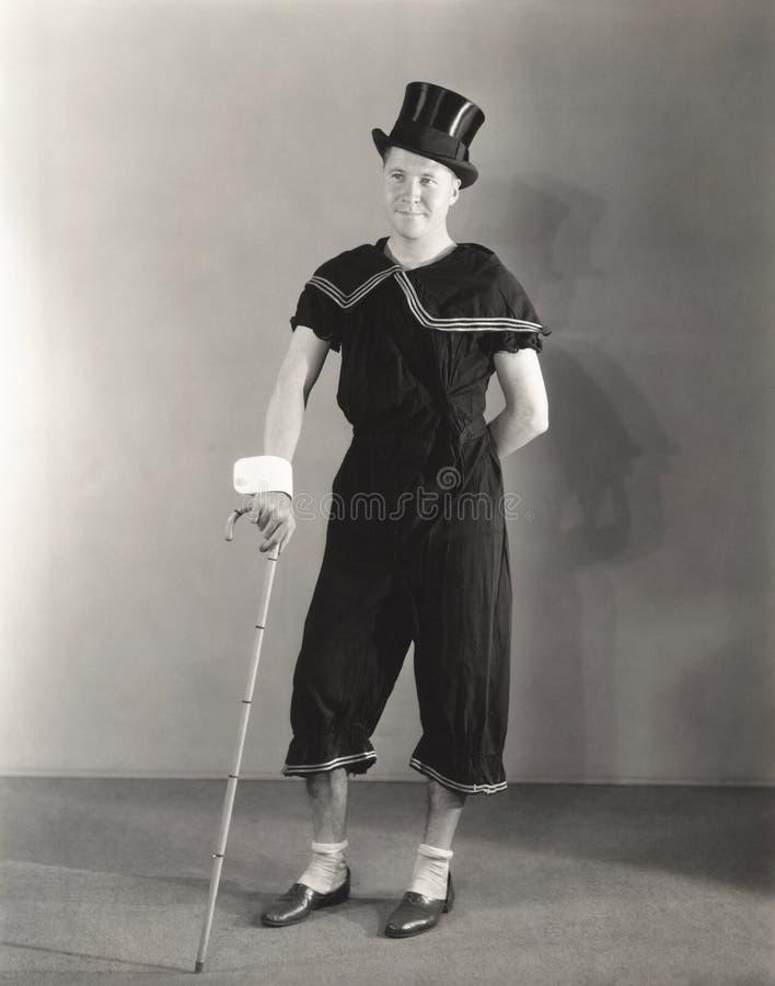Équipez la pose dans les manchettes, le chapeau supérieur et le costume de cirque photos libres de droits