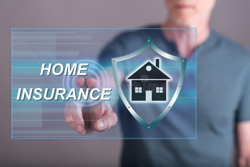 Équipez toucher un concept à la maison d'assurance sur un écran tactile photographie stock libre de droits