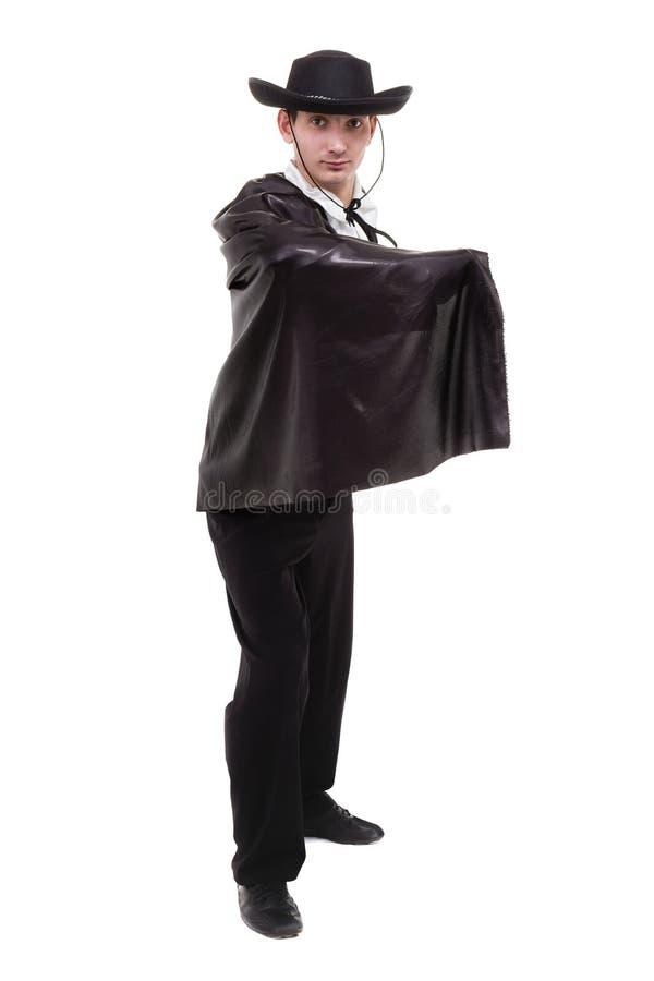Équipez utiliser un costume de zorro posant, sur le blanc image stock