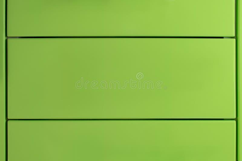 Étagères vertes du coffret de meubles Texture de peinture verte brillante photo stock
