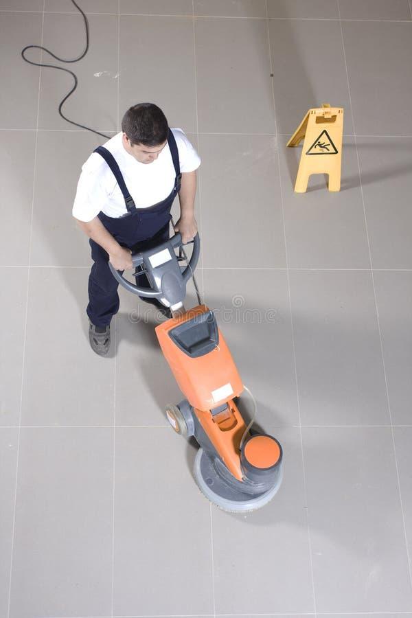 Étage de nettoyage avec la machine photos libres de droits