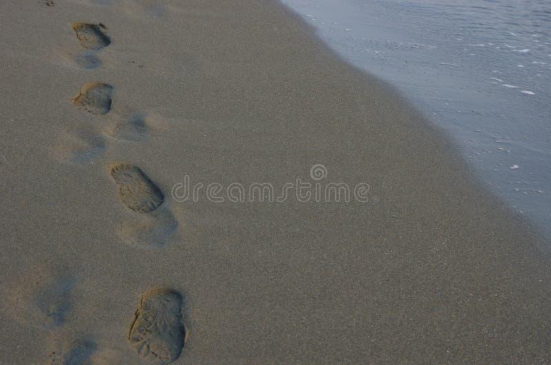 Étape sur la plage images libres de droits