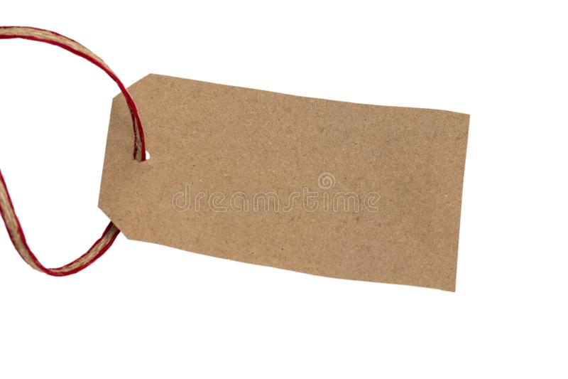 Étiquette blanc attachée avec la chaîne de caractères Label de papier RP brunes vides de carton images stock