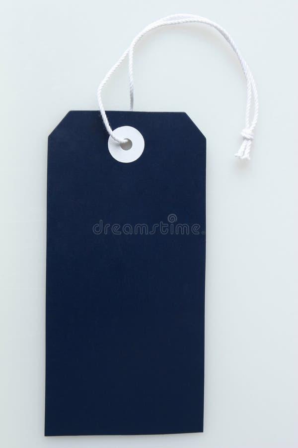 Étiquette bleu-foncé photographie stock