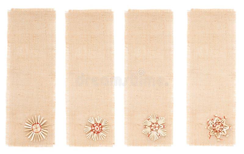 Étiquette de toile à sac avec le décor de paille. images stock