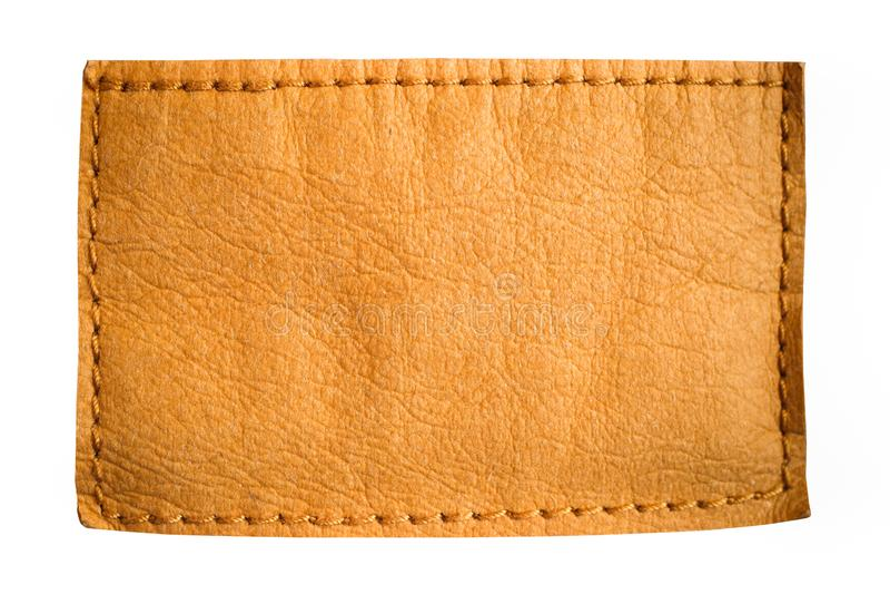 Étiquette en cuir de label de jeans de blanc dans la couleur jaune brun clair avec l'espace vide clair pour le texte ou la concep photos stock