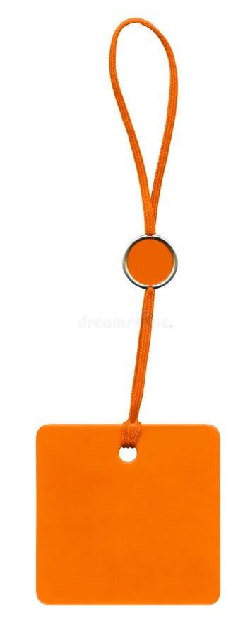 Étiquette orange de glam avec le lacet rouge photos stock