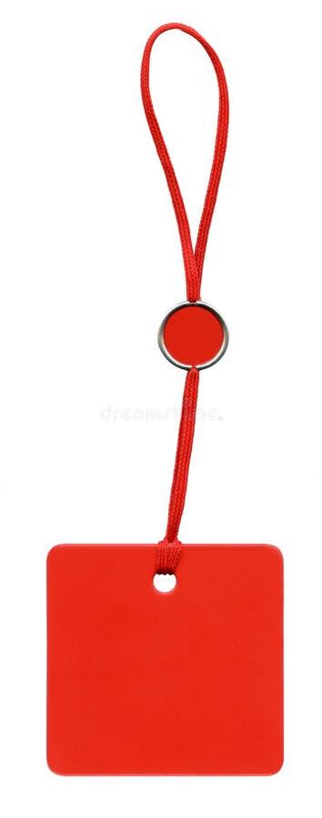 Étiquette rouge de glam avec le lacet rouge photo libre de droits