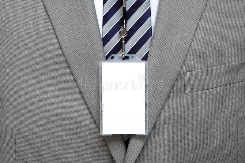 Étiquette nommée vide sur le costume photographie stock