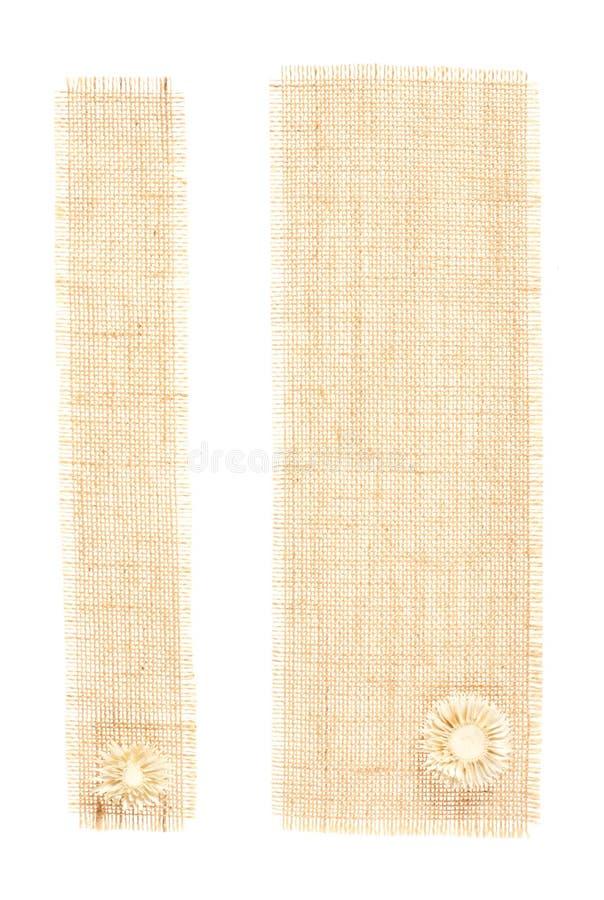 Étiquettes de toile à sac avec le décor au-dessus du blanc images stock