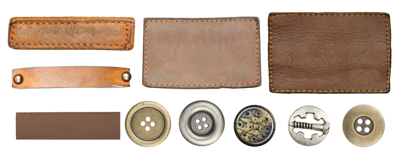 Étiquettes et boutons de jeans image stock