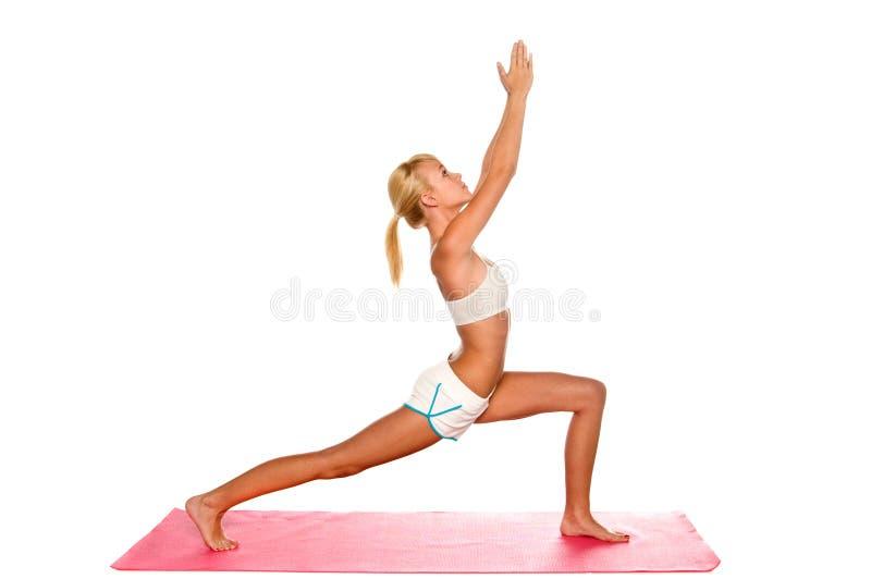 Étirage de femme de yoga image libre de droits