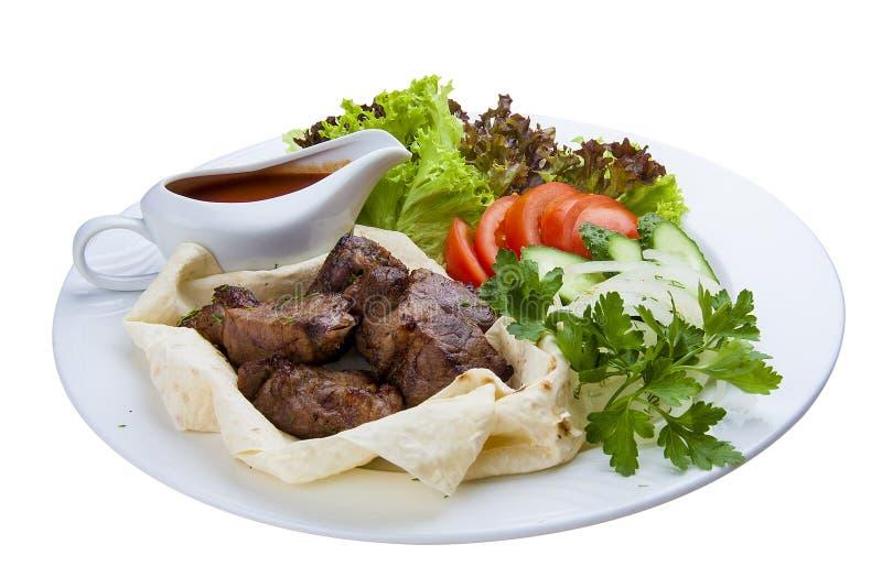 Étoffez le chiche-kebab en pain pita D'un plat blanc photos stock
