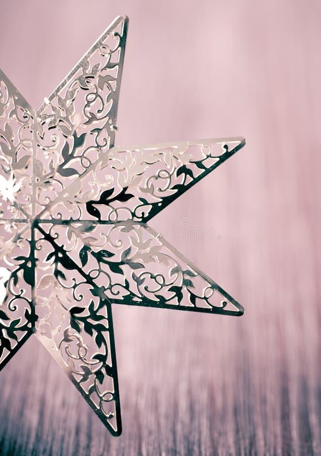 Étoile d'or de Noël dans un type de cru images libres de droits