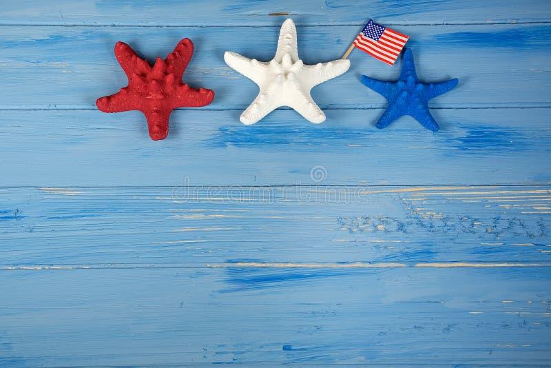Étoiles de mer patriotiques avec le drapeau image stock
