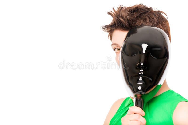 étranger par derrière le masque noir brillant photographie stock libre de droits