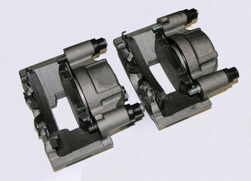 Étriers de frein avec des garnitures de frein image stock