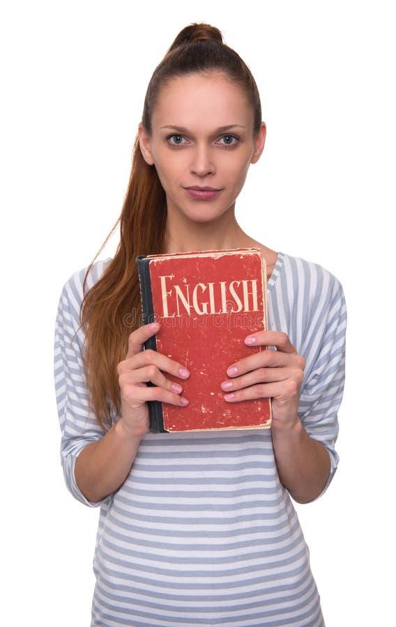 Étude du concept anglais Jolie fille tenant un livre photos libres de droits