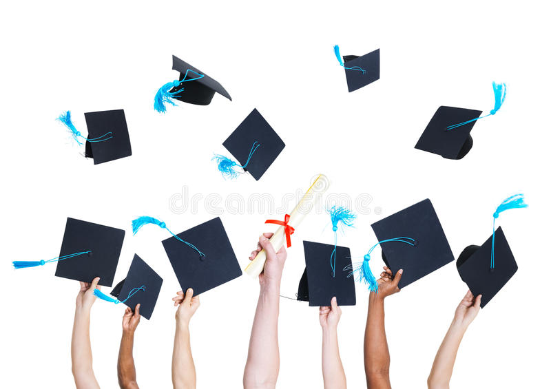 Étudiant de graduation Throwing Graduation Hats photo libre de droits
