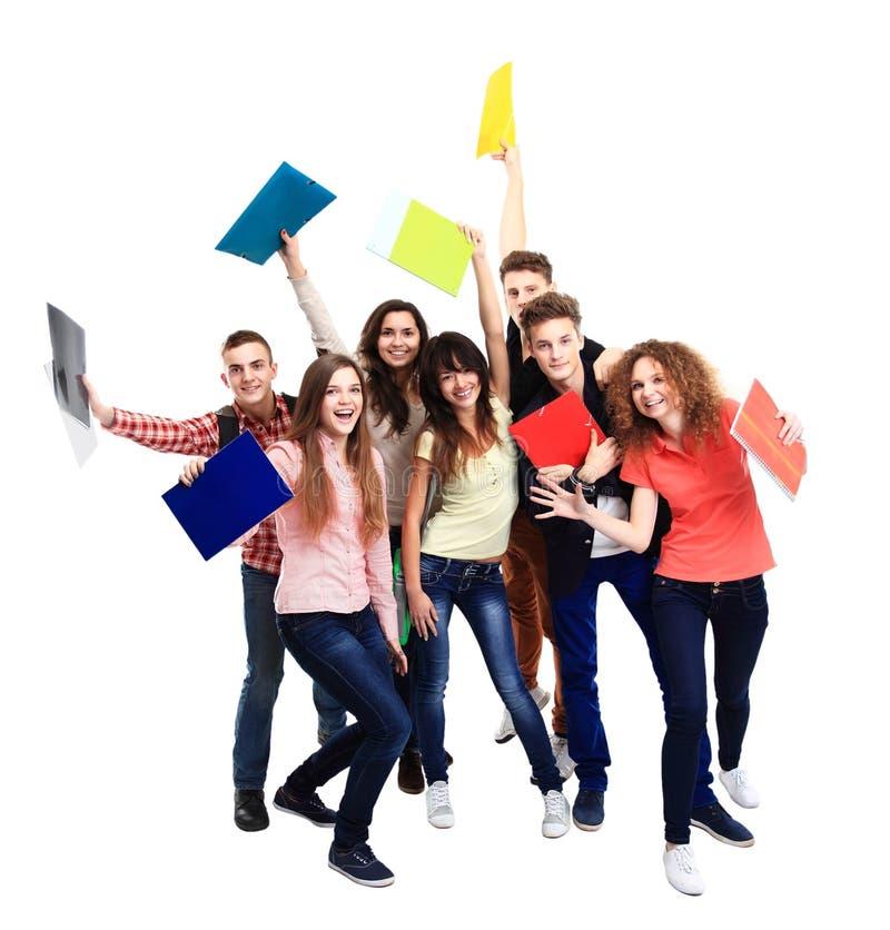 Étudiant de groupe avec le carnet photo stock
