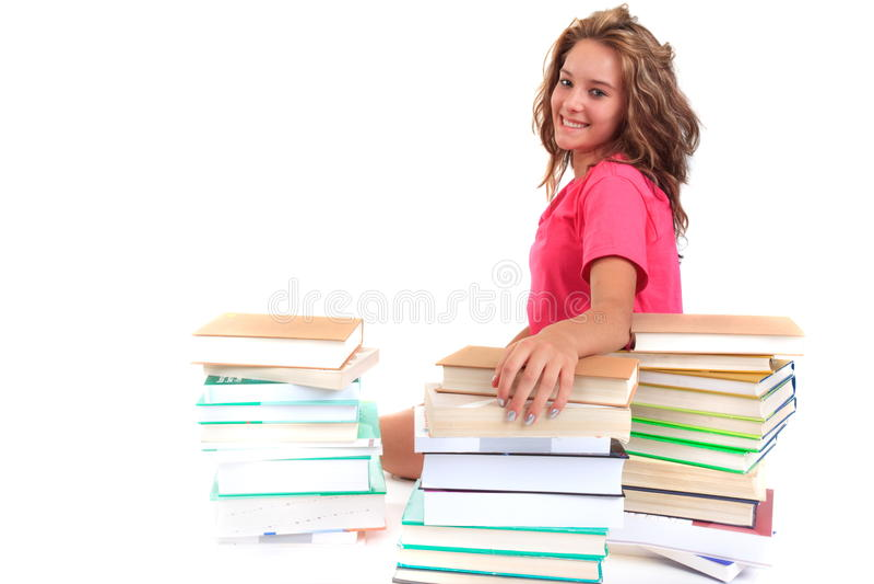 Étudiant de sourire avec des livres photos stock