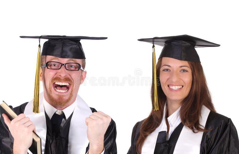 Étudiant deux réussi dans des robes de graduation photos stock