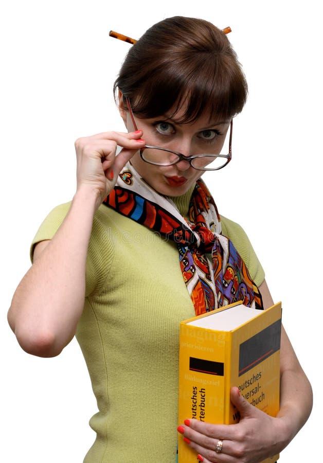 Étudiant drôle avec un dictionnaire image stock