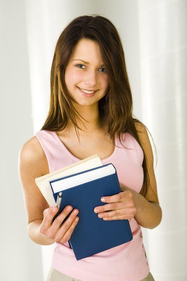 Étudiant féminin avec des livres images libres de droits