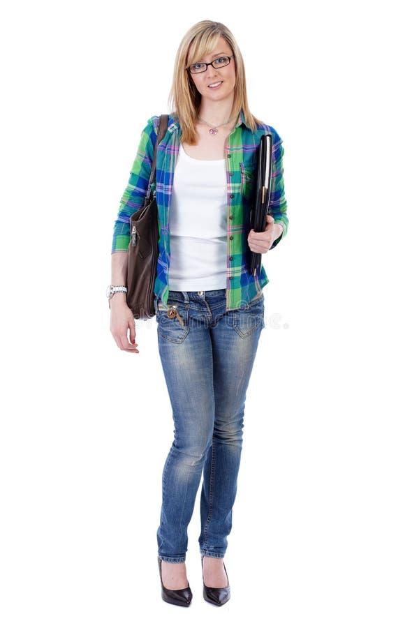Étudiant féminin blond attirant heureux, d'isolement image stock