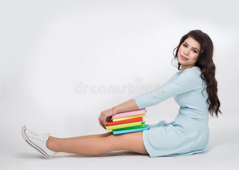 Étudiante avec des livres photo libre de droits