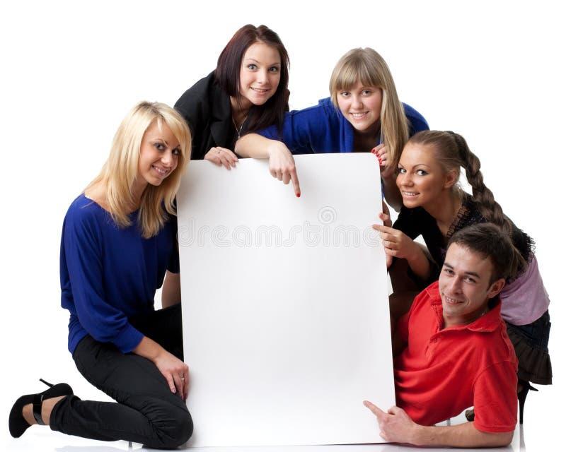 Étudiants avec le signe blanc photo stock