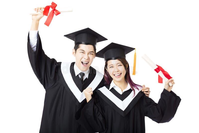 Étudiants d'éducation d'homme et de femme d'obtention du diplôme photo stock