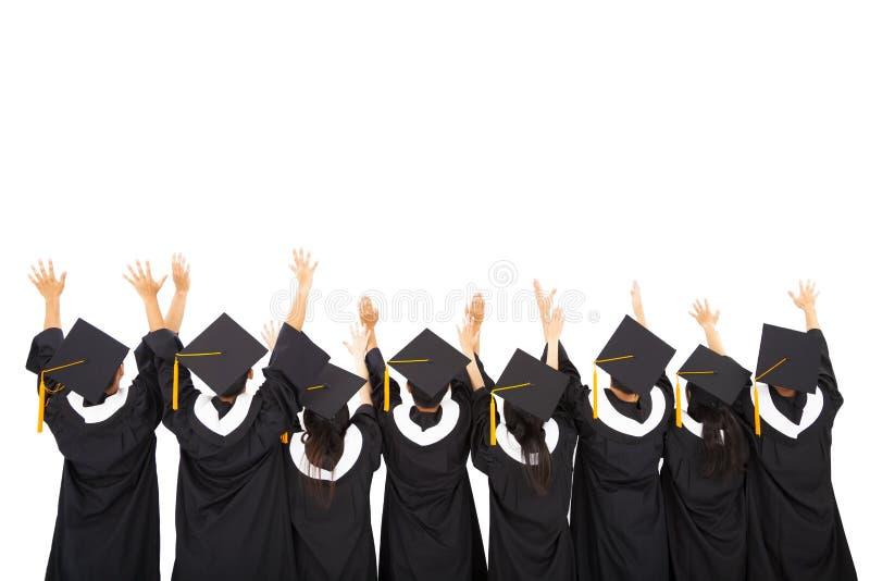 Étudiants de vue arrière célébrant l'obtention du diplôme photo stock