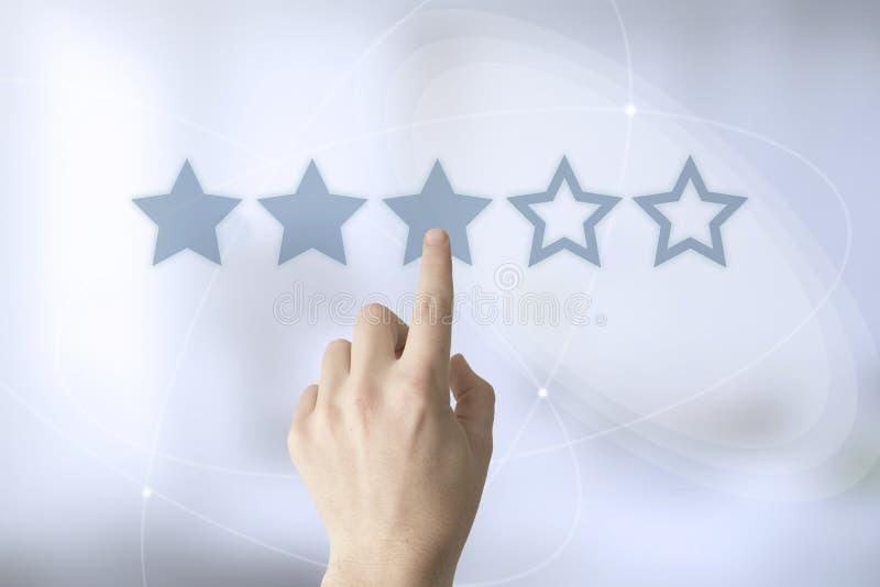 évaluation de main trois-étoiles photo stock