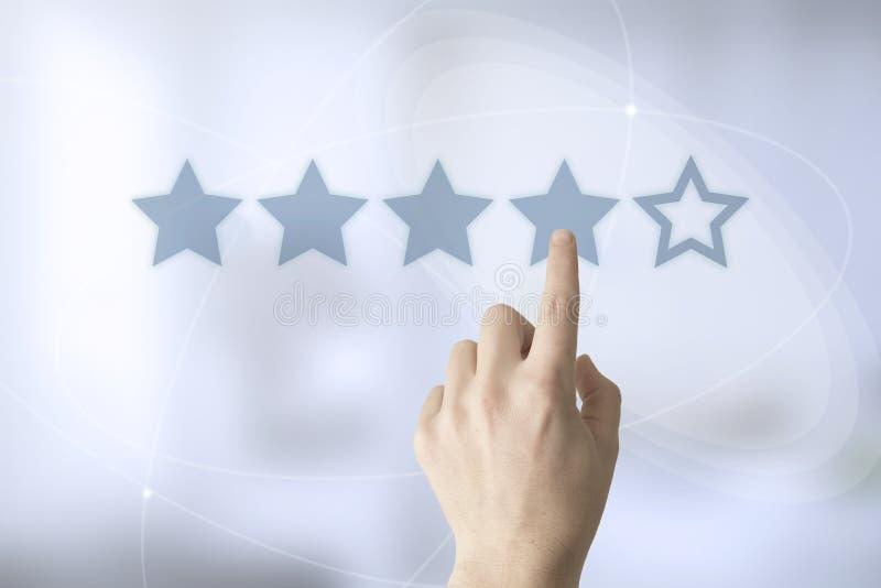 évaluation de main trois-étoiles image stock