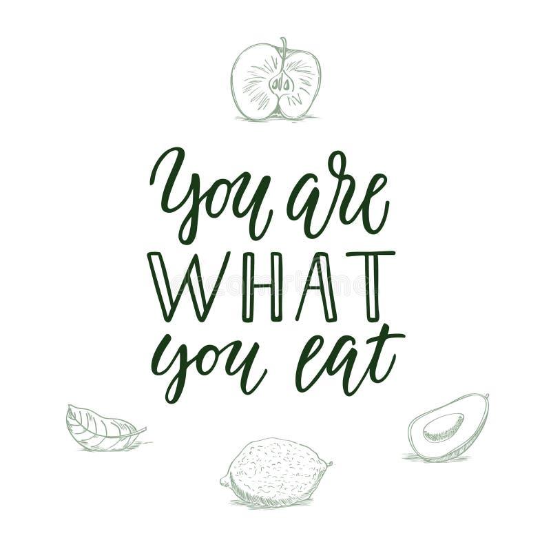 Êtes vous ce que vous mangez ! Citation et veggi/fruit calligraphiques sur le fond photographie stock