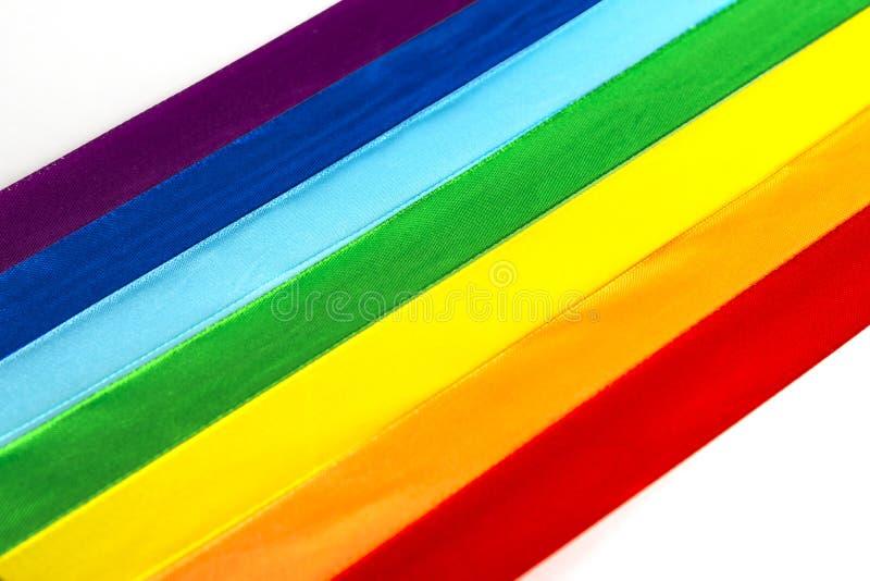 Ícone da bandeira da fita do cetim de LGBT no fundo branco imagem de stock royalty free