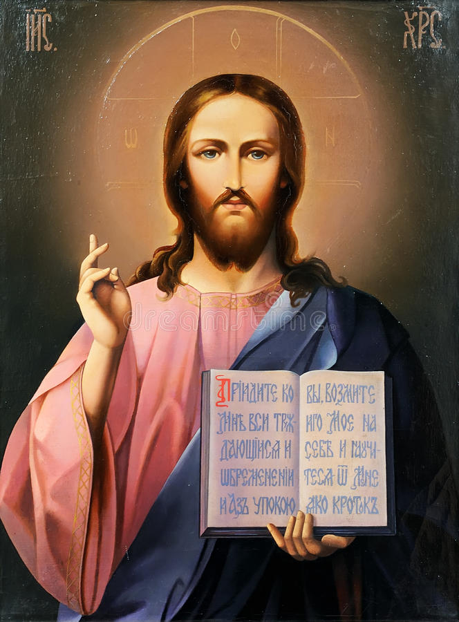 Ícone do Jesus Cristo com a Bíblia aberta foto de stock royalty free