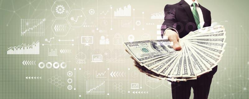 Ícones e gráficos virtuais com o homem de negócio com dinheiro imagem de stock