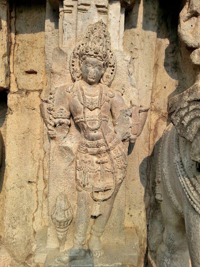 Ídolo tallado en el muro exterior del Templo de Kopeshwar, Khidrapur, Kolhapur, Maharashtra, India fotos de archivo