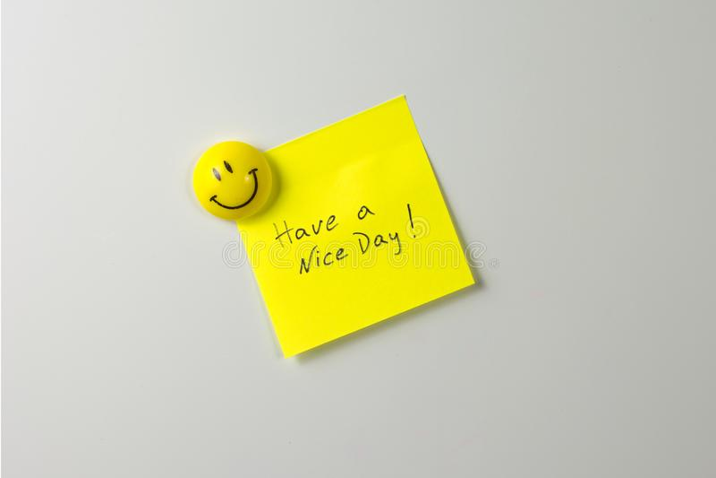 ímã de sorriso em um refrigerador branco imagem de stock royalty free