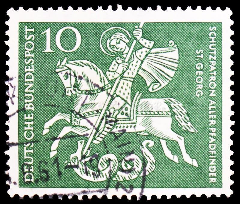 Άγιος George (Dragonslayer), προστάτης Άγιος των ανιχνεύσεων αγοριών, γερμανικές ανιχνεύσεις αγοριών serie, circa 1961 στοκ εικόνα